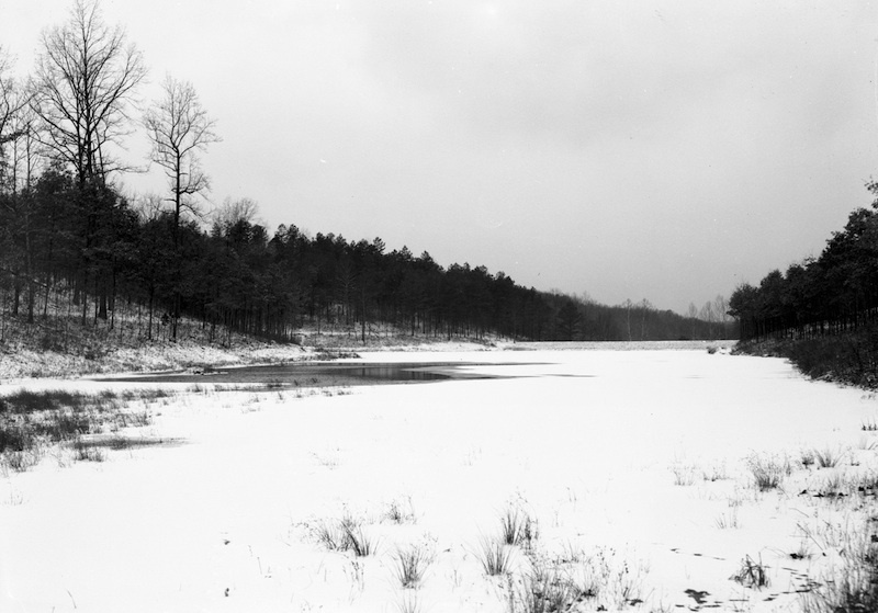View of Bear Lake with snow, Shawnee State Forest, Scioto County, Ohio (c. 1935).