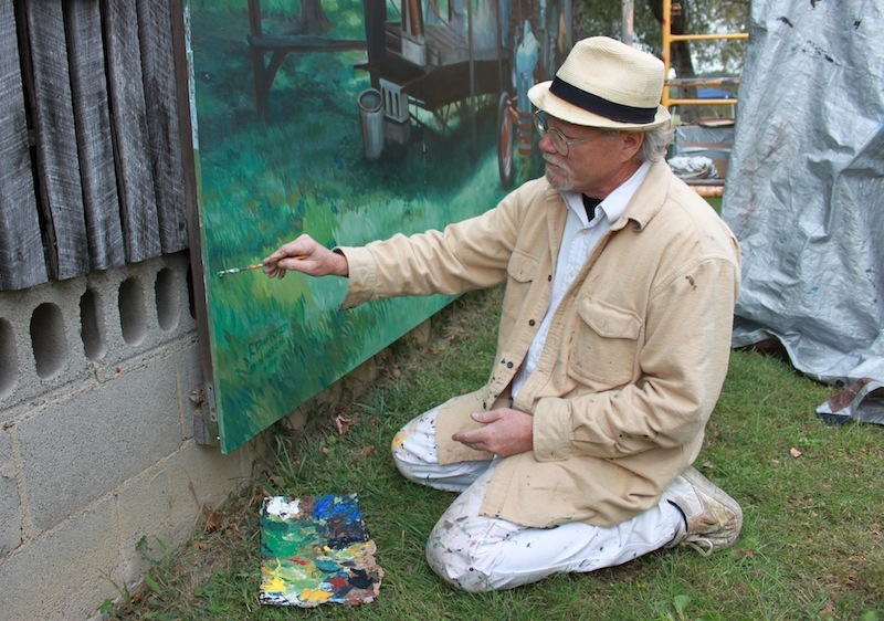Robert Dafford, touching up his mural of John Simon, during Simon's annual Sorghum Festival, Scioto County, Ohio (6 October 2012).