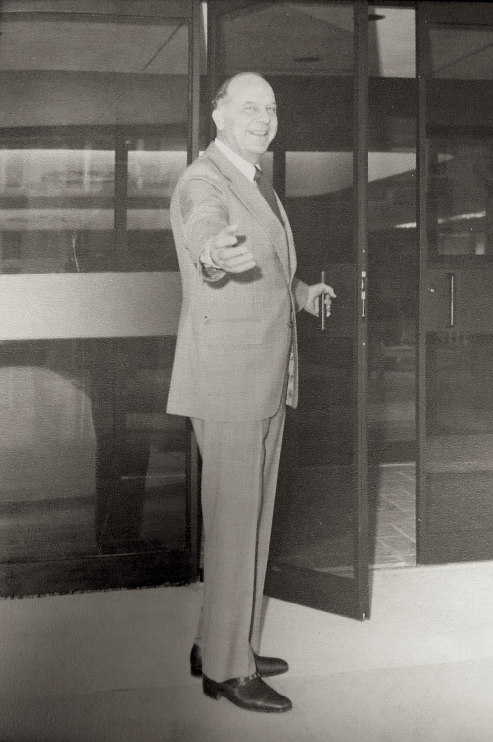 Harry Kuhner, president of Security Central National Bank, opening the door to the newly relocated bank headquarters on the Esplanade, Portsmouth, Ohio, c. 1976.