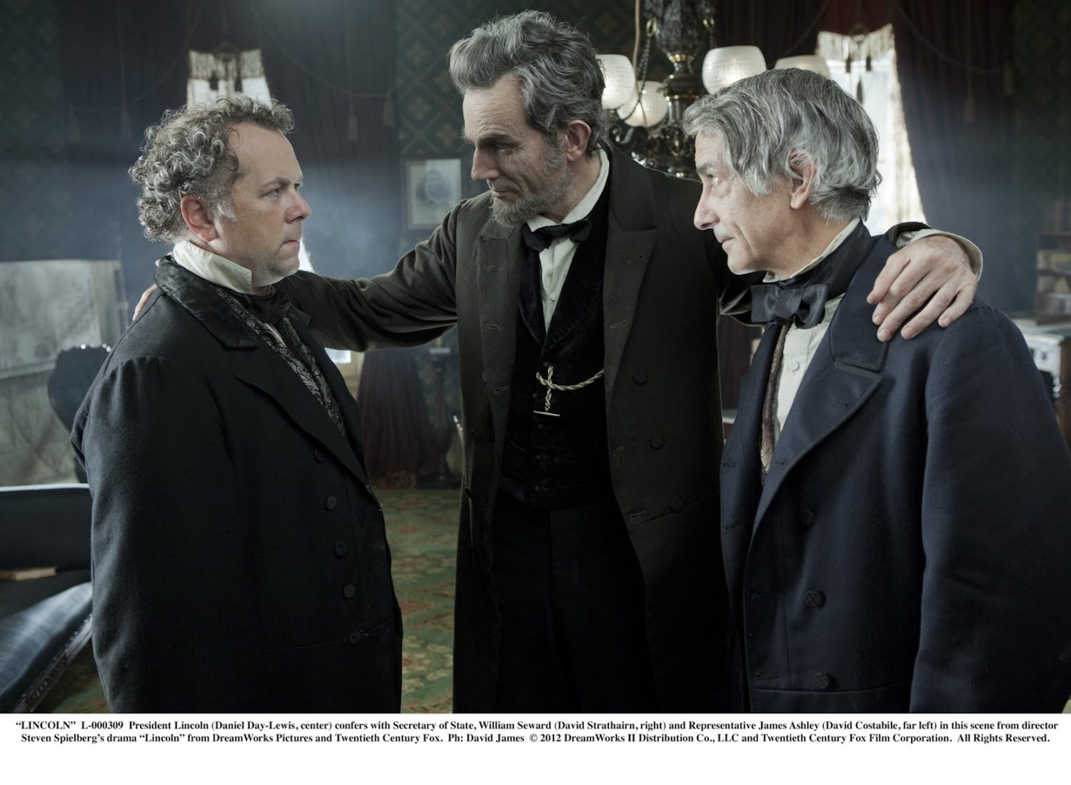 """Abraham Lincoln (Daniel Day-Lewis, center) consults with James Ashley (David Costible, left) and William Seward (David Strathairn, right) in Steven Spielberg's drama """"Lincoln"""" from DreamWorks Pictures and Twentieth Century Fox."""